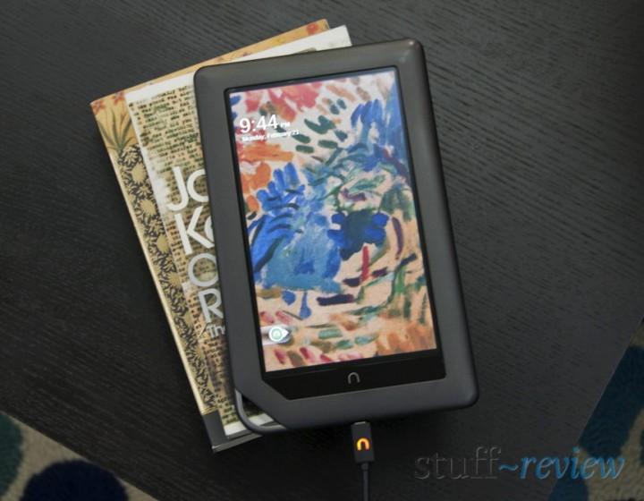 Nook Color ~ Hardware ~ Charging with USB cable on a pile of books