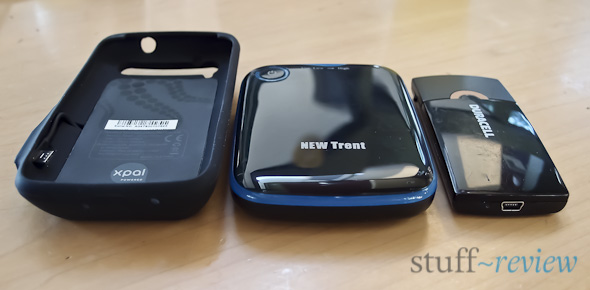 External battery roundup review: from left to right, PowerSkin protective case, New Trent IMP500 and Duracell Instant USB Charger
