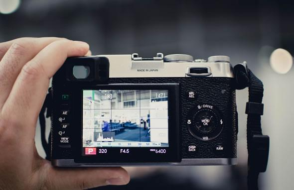 Fujifilm X100 held in hand