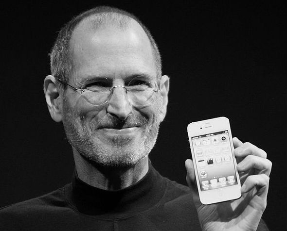 Steve Jobs holding and iPhone
