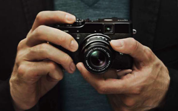 Fujifilm FinePix X10 point-and-shoot camera in hand