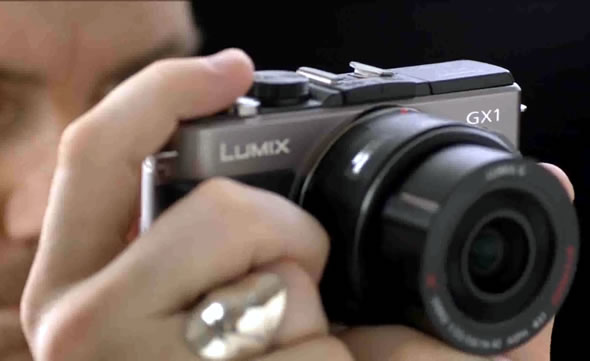 Panasonic Lumix GX1 MFT camera in hand