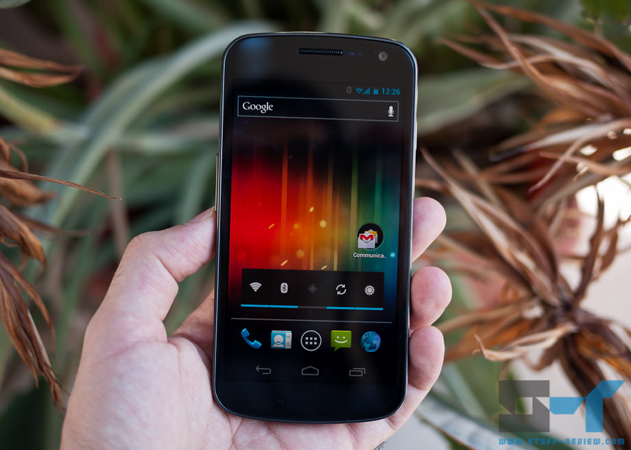 Samsung Galaxy Nexus in hand - on homescreen