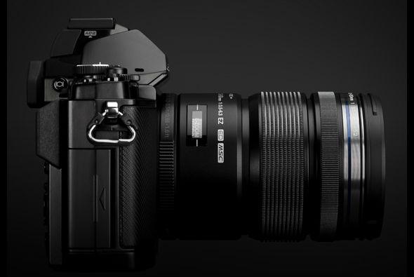 Olympus OM-D E-M5 MFT camera in black side with 12-50mm lens