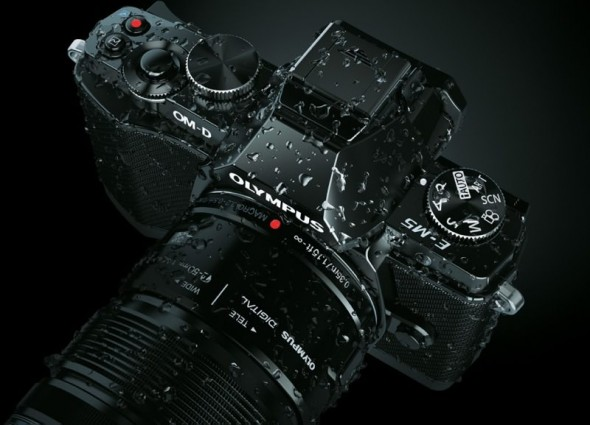 Olympus OM-D E-M5 MFT digital camera wet demonstrating weather-sealing