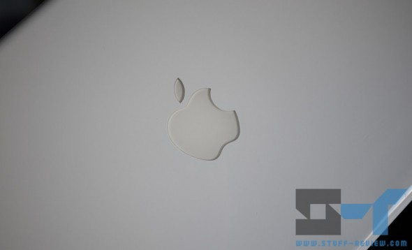 White plastic MacBook - Apple logo close-up