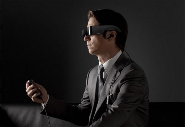 EPSON Moverio BT-100 Android 3D glasses and controller worn by a man