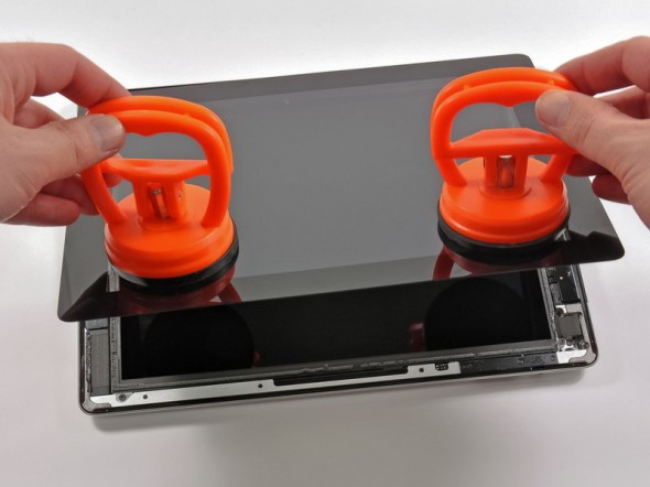 3rd generation iPad teardown pulling the front with suctions cups
