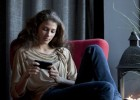 Woman playing with Sony Xperia Sola Android smartphone