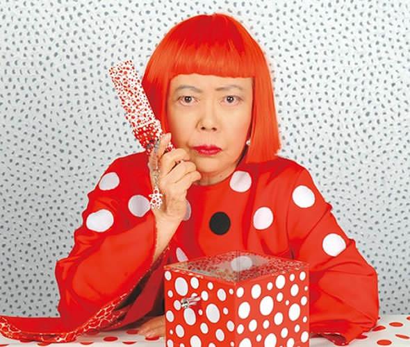Yayoi Kusama portrait photo with dots