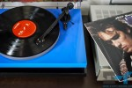 Turntable loaded with vinyl record and album cover