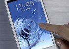 Samsung Galaxy S III white finger touching screen