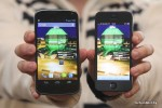 LG Google Nexus vs. iPhone 5 front in hand